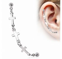 Double piercing cartilage oreille étoile croix