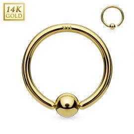 Piercing anneau boule fixée en or jaune 14 carats