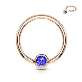Piercing anneau captif or rosé cristal bleu